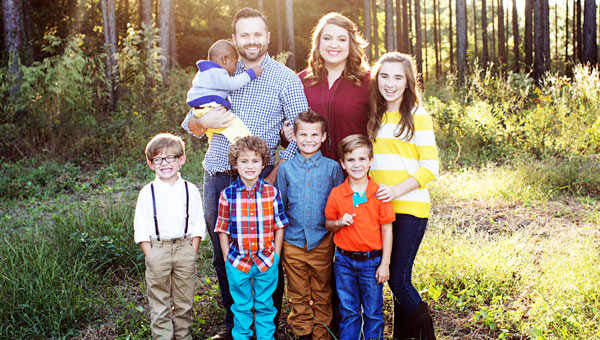 When the Houston family first entertained the idea of adoption, they had no idea that they would soon be blessed with four more children.  Pictured are, first row from left to right,  Raleigh, Joseph, Caleb and Timothy.  Pictured are, second row from left to right, Elijah, George, Jay and Sarah Jane Houston.