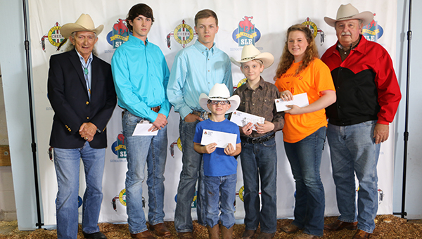 Pictured are, from left to right, Billy Smith, Poarch Band of Creek Indians; Colby Smith, Calhoun County; Austin Smith, Calhoun County; Jerry Fuller, Butler County; Joe Johnson, Butler County; Cayla Snell, Barbour County; and Alabama Cattlemen's Association Vice President Jack Batts. (Submitted photo)