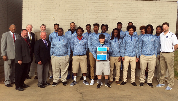 The Butler County Commission recognized Georgiana School's record-setting season during its regular meeting and presented head coach Kirk Norris and his team with a plaque honoring the team's accomplishments. (Advocate Staff/Andy Brown)