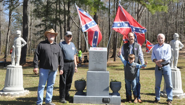 To celebrate National Confederate Flag Day, the Sons of Confederate Veterans (SCV) heritage group held a flag raising ceremony. Pictured are, from left to right,  Commander for the Ben Bricken Camp 396 David Coggins,  Southeast Brigade Commander Joe Clark, Jr.,  Commander-in-Chief for the national SCV group Kelly Barrow, William Barrow and  Alabama Division Adjutant Mike Williams. (Photo by Beth Hyatt)