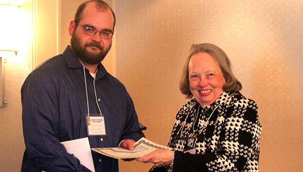 """LBW Community College student Daniel Lawrence, of Greenville, left, recently received the 2016 Mary Evelyn McMillian Undergraduate Writing Award from Association of College English Teachers of Alabama (ACETA) President Gloria Horton for his essay, """"The Weight of a Lesson."""" (Submitted photo)"""