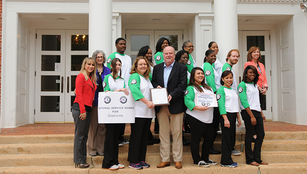 Pictured are, first row, from left to right, Dr. Tera Simmons, Brittney Kyle, Stacy Charlton, Mayor Dexter McLendon, Jayde Windham, Joy Matthews and Patrice Parmer. Second row, from left to right, AmeriCorps Director Carol McArthur, Franchasca Hatcher, Shelia Albritton, Erica Johnson, Andrew Jones and Superintendent Amy Bryan. Third row, from left to right, Lavarus Peagler, Davida Hayden, Debra Canaty and Cassandra Hawkins. (Advocate Staff/Andy Brown)