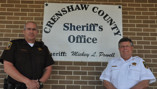 After being recently appointed as chief deputy for the Crenshaw County Sheriff's Office, Mike Johnson is ready and willing to answer the call of duty. Pictured are, from left to right, chief deputy Mike Johnson and Crenshaw County Sheriff Mickey Powell. (Photo by Beth Hyatt)