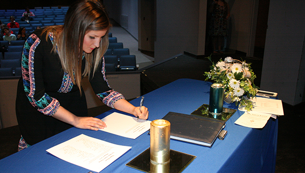 LBW Community College's recent spring induction ceremony in Andalusia for the Alpha Beta Eta Chapter of Phi Theta Kappa included 58 new members. Pictured is LBWCC Ensemble member Morgan Tillman as she participates in the ceremony.