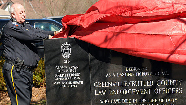 Greenville Police Chief Lonzo Ingram unveils the law enforcement memorial bearing the names of officers who have been killed in the line of duty. (Advocate Staff/April Gregory)
