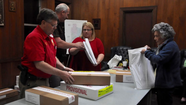 Ballot boxes arrived at the Crenshaw County courthouse Tuesday night after polls across the county closed.  The ballots were sorted and received by officials in the Crenshaw County Sheriff's Office.  Pictured are Sheriff Mickey Powell,  Chief Deputy Mike Johnson,  office manager for the Crenshaw County Sheriff's Office Jennifer Knighten and Irene Fowler. (Photo by Beth Hyatt)