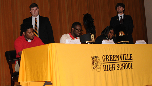Greenville High School seniors Stephen Cook, Devin Gavin and JaFreshia Shepherd signed music scholarships with Alabama State University during a ceremony held Tuesday at the Greenville High School auditorium. Pictured are, seated from left to right, Cook, Gavin and Shepherd. Standing, from left to right, Dr. Bryan Reeves, director of the concert band at Alabama State, and Brett Johnson, GHS band director. (Advocate Staff/Andy Brown)