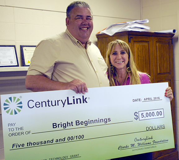 Jeff Adams, area supervisor at CenturyLink, presented Dr. Tera Simmons with a $5,000 check on Thursday through the CenturyLink Clarke M. Williams Foundation's Teachers and Technology program. The funds will be used to purchase a WePlaySmart Multi-Touch Table for Bright Beginnings. (Advocate Staff/Andy Brown)