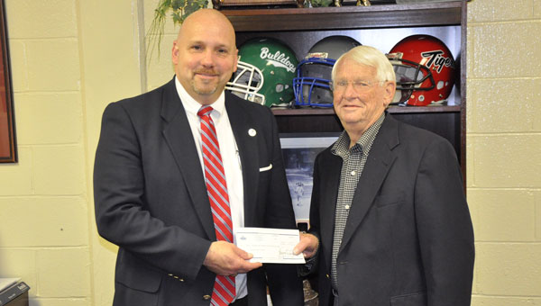 Crenshaw County Schools recently received $12,716 for the 2016 school year from the Southeast Alabama Gas District (SEAGD). Pictured are, from left to right, Superintendent of Crenshaw County Schools Boyd English and SEAGD board member Joe Rex Sport.