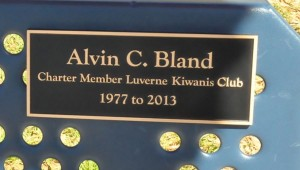 Alvin Bland served as a charter member of the Luverne Kiwanis Club. His plaque is mounted on one of the benches inside the playground. (Photo by Beth Hyatt)