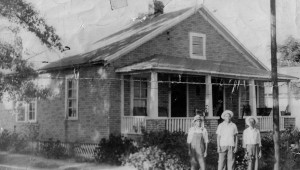 Leola Tisdale Johnson's grandfather, father and uncle in front of the childhood home where she and Charlie currently live.