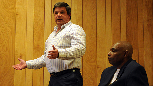 Michael Smith, co-owner of MJ's Kitchen and Bath Supplier, discusses the company's plans with City of Georgiana and Butler County officials during a meeting in December. (File photo)