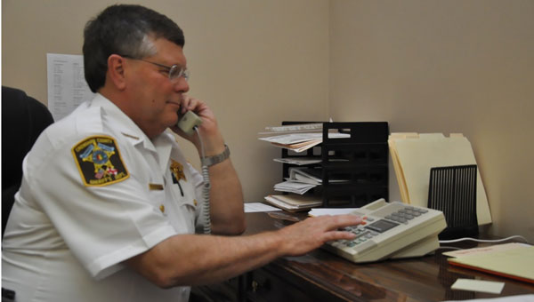 Crenshaw County Sheriff Mickey Powell says on average the office has received 10 phone calls per week regarding the recent IRS phone scam.  (Photo by Beth Hyatt)