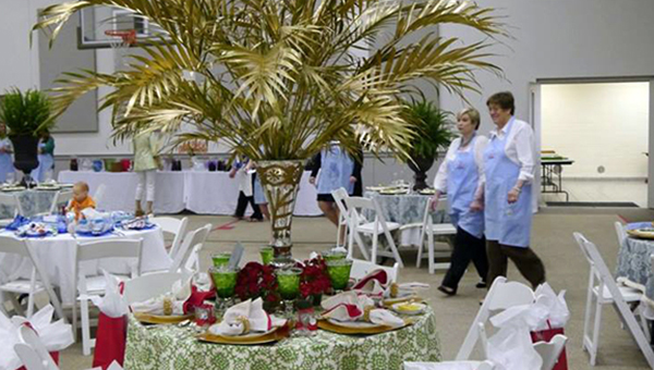 """The Golden Palm Fronds table by April Sherling and Daisy Norman won """"People's Choice"""" and also was selected third overall by the judges at Tablescapes on Saturday. (Advocate Staff/Angie Long)"""