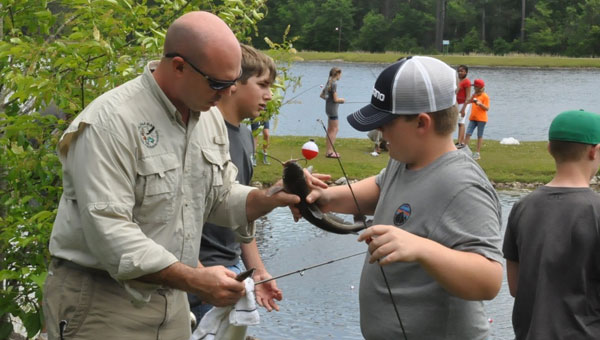 Sixth grade honor students from Crenshaw Christian Academy, Luverne High School. Highland Home School and Brantley High School had the chance to go to the Crenshaw County Lake last week to enjoy a day of fishing with the Luverne Rotary Club. (Photo by Beth Hyatt)