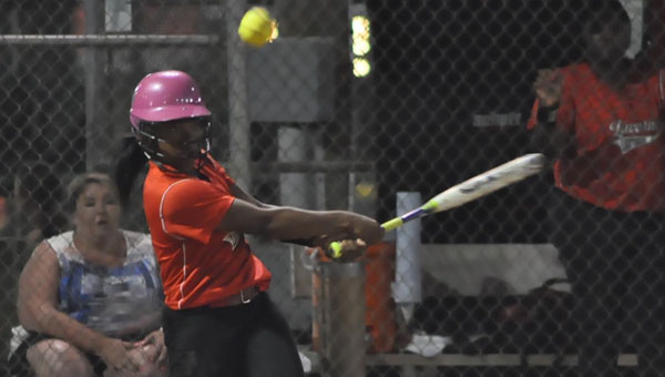 J'asha Mitchell takes her turn at the plate and succeeds in making a hit for the LHS Lady Tigers.