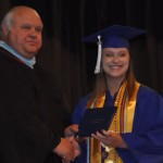 Valedictorian Kayla Sipper proudly accepts her diploma from headmaster Gary Driver.  (Photo by Beth Hyatt)