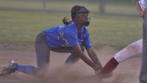 Lady Squadron junior Allera June reaches to tag a runner out on second.