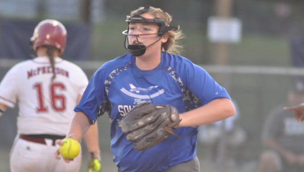 Lady Squadron freshman Gracie Whiddon prepares to throw a runner out at home.