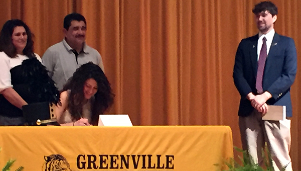 Greenville High School senior Jennyfer Maciel signed a band scholarship with UAB on Thursday. Pictured are, seated, Jennyfer Maciel. Standing, from left to right, Alicia Maciel, Daniel Maciel and GHS Band Director Brett Johnson. (Courtesy photo)