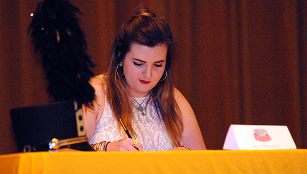 Greenville High School senior Mary Margaret LeCoq signed a band scholarship with the University of Alabama on Tuesday. (Advocate Staff/Andy Brown)