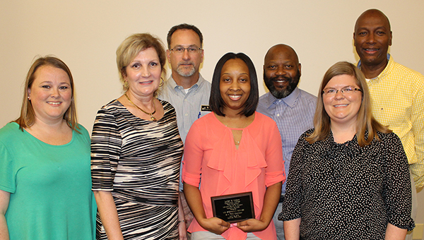 Breshawn Skinner, LBW Community College financial aid assistant director, center, is the 2016 TRIO Champion, named by LBWCC's Student Support Services (SSS) and Upward Bound (UB) TRIO programs. Pictured are, front row from left, Tori Norris, SSS coordinator in Greenville; Dr. Pat Powell, SSS director; Skinner; Kelley Nolen, SSS coordinator in Andalusia; second row, Dr. Jason Cain, SSS coordinator in Opp; William R. Hines, Upward Bound counselor and curriculum coordinator; and Bridges Anderson, Upward Bound director. (Submitted photo)
