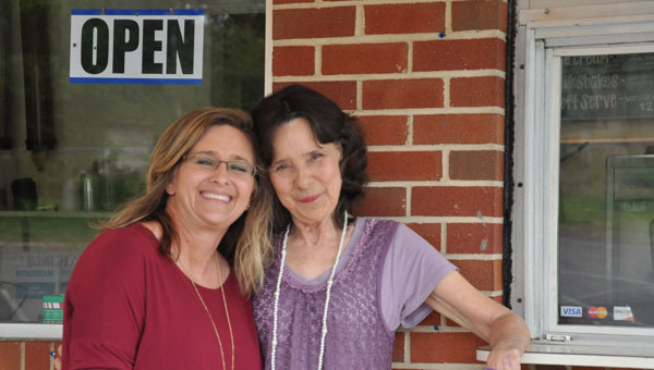 Sue Bass posses with her daughter-in-law SalLee Sasser-Williams at The Chicken Shack window. (Photos by Beth Hyatt)