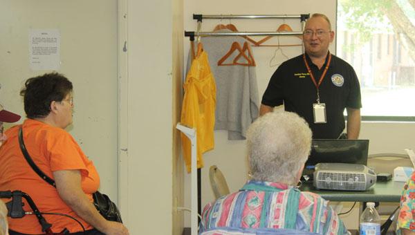 Emergency Management Agency director Elliott Jones speaks to the senior citizens of the Brantley Senior Center on the importance of emergency preparedness. (Photo by Shayla Terry)