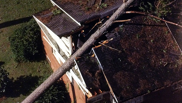 A house on Overlook Drive took a direct hit from a falling tree crushing parts of its roof when in 2004 Hurricane Ivan marched through Butler County bringing with it 100 mph winds. (File photo)