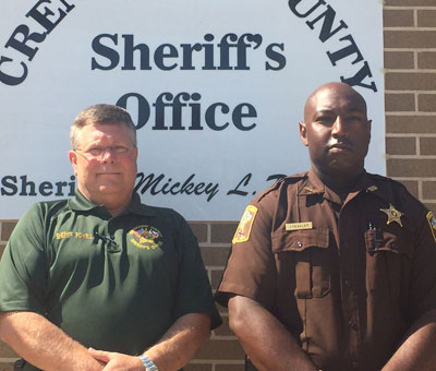Georgiana native Jeremy Peagler (right) reported for his first day on the job as a new deputy for the Crenshaw County Sheriff's Office on Tuesday. Peagler is the first African American deputy to be hired in the past 10 years. (Photo by Beth Hyatt)