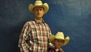 Kelly Carpenter and his son Colton enjoy the atmosphere of the rodeo and are excited to be involved in the thrill of the ride. (Photo by Beth Hyatt)