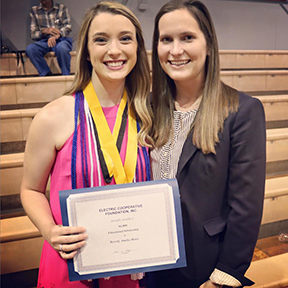 Pioneer Electric Cooperative Communication Specialist Casey Rogers presents Lowndes Academy graduate Millie Motes  with 2016 Electric Cooperative Foundation, Inc. Scholarship. (Submitted photo)