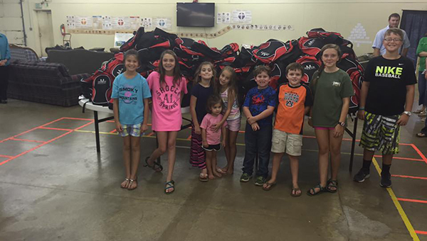 Volunteers have packed more than 300 backpacks with school supplies, and hope to distribute those backpacks to area school children during the second annual Elementary Extravaganza Sunday at Southside Baptist Church in Greenville. (Courtesy photo)