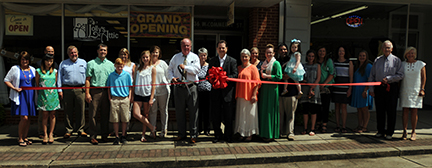 Greenville Mayor Dexter McLendon and members of the Greenville Area Chamber of Commerce helped welcome Lolly's Attic to town with a ribbon cutting ceremony Wednesday. The business is owned by Darryl and Melinda Freeman and managed by the couple's daughter, Amberlin Salas. (Advocate Staff/Andy Brown)