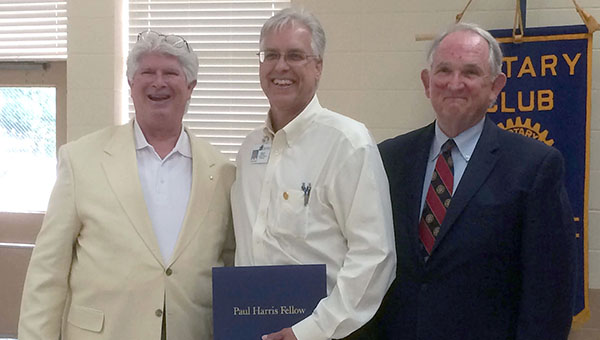 The Rotary Club of Greenville recognized David Norrell as a Paul Harris Fellow at its meeting Thursday at Beeland Park. Pictured are, from left to right, Assistant District Governor Keith Roling, David Norrell and Dr. Jim Krudop. (Advocate Staff/Andy Brown)