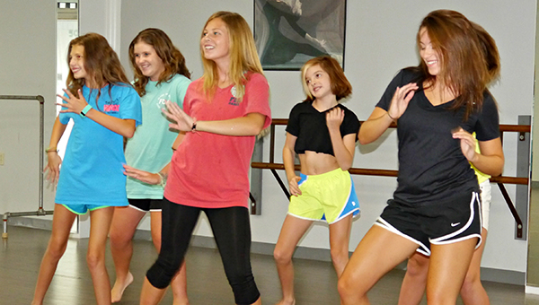 Level II dancers (from left) Claire Hutson, Mary Virginia Meadows,Xada Ingram, Zoe Coon and Kendall Burt let down their hair and let it whip while performing a sassy salsa number as part of their World Dance studies at 'Elevate' camp.