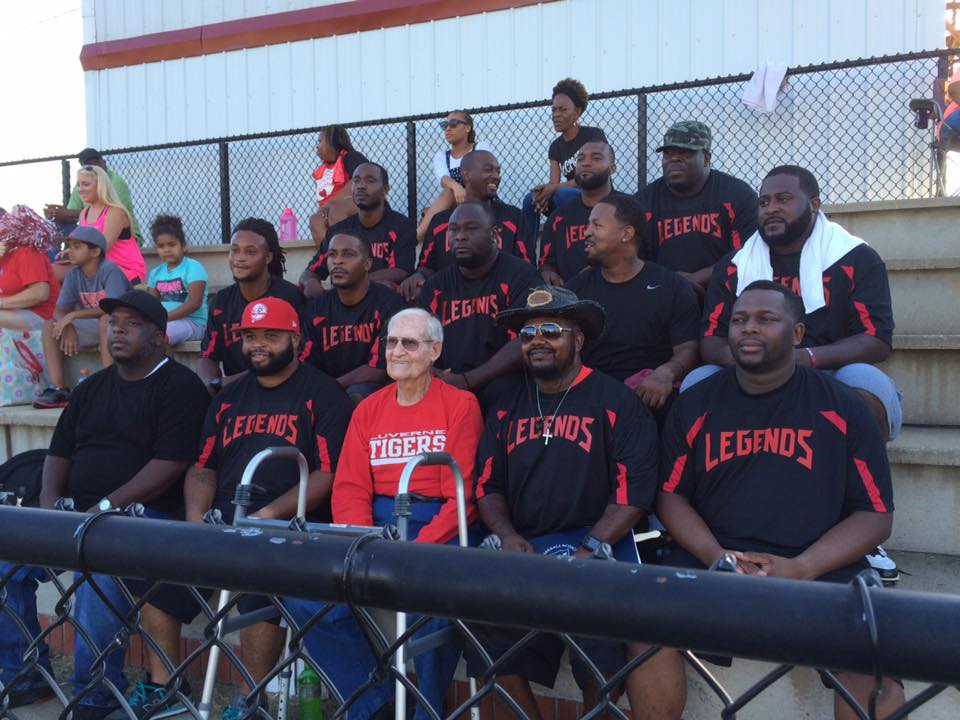 """Former LHS coach Glenn Daniel sits with his group of """"Legends"""" at the recent alumni football game held at LHS.  At the end of the evening, Daniel was presented a trophy for his service to LHS."""