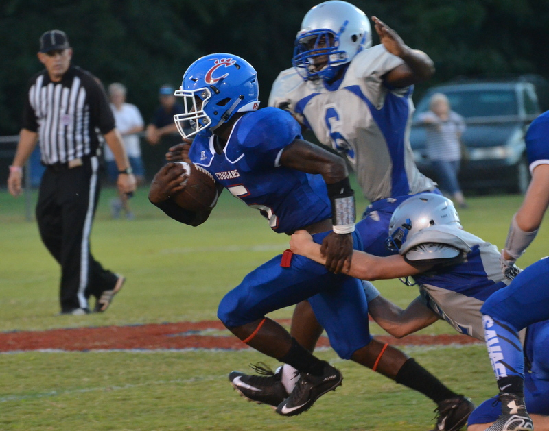 Junior running back Quashaun Laprade struggles to get out of the clutches of the Chiefs.