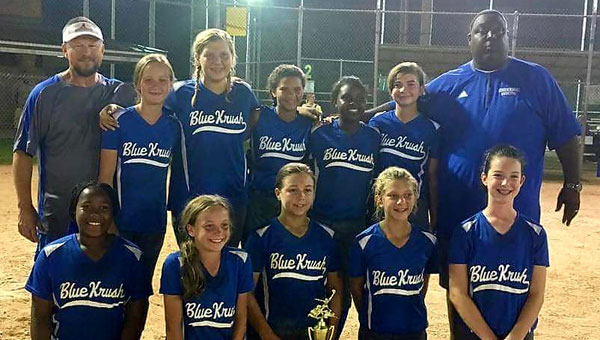 The multi-county Blue Krush fastpitch travel softball league has blossomed from its humble beginnings as a 10-and-under team to five teams across four different age groups in the span of two years. Pictured, back row from left to right, is coach Gary Rushing,  Maggie Furr,  Grace Rushing, Micaiah June, Sheonte' Barginere,  Emily Strickland and coach Marvin Barginere. Pictured, front from left to right, is Dakota Seymour,  Cahley Acreman, Alana Wheeler,  Ally Rushing and Carissa Gilbert.