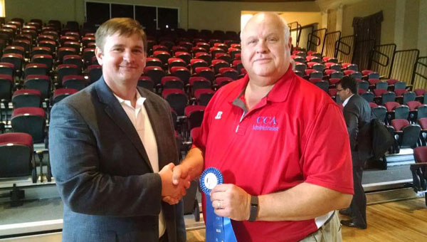 CCA was presented the Blue Ribbon Award by AISA Academic Programs Director Michael McLendon. CCA is one of 27 Alabama private schools receives the award.