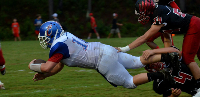 Senior quarterback Cole Roper dives for a first down for the Cougars.  (Photo courtesy of Merica Tisdale)