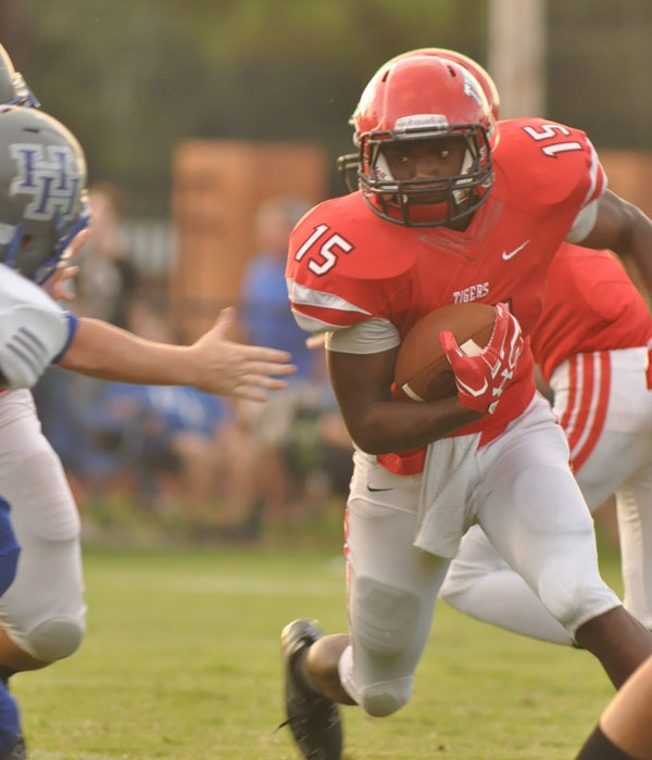 LHS junior running back Marcus McGhee goes for a first and goal for the Tigers at the end of the first quarter. (Photos by Beth Hyatt)