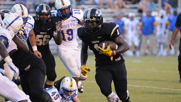 Greenville High School senior Dedric Owens looks for running room during the first quarter of the Tigers' 39-13 loss to Beauregard High School Friday night. (Advocate Staff/Andy Brown)