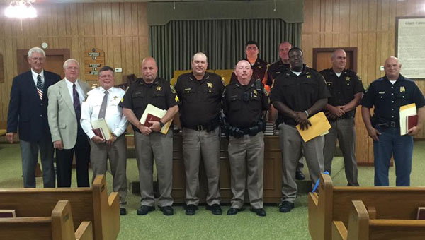 Pictured are, from left to right, Harry Driggers, pastor of Siloam Baptist Church; Ben Chandler, director of missions for the Alabama Crenshaw Baptist Association; Mickey Powell, Crenshaw County Sheriff; Srgt. John Powell; Srgt. Carlton Carmichael; Srgt. Dalton Frances; Matthew Johnson; Amphernee Canty; Lee Simmons; Mike Johnson, Crenshaw County Chief Deputy; and Gary Pete, Alabama State Trooper.