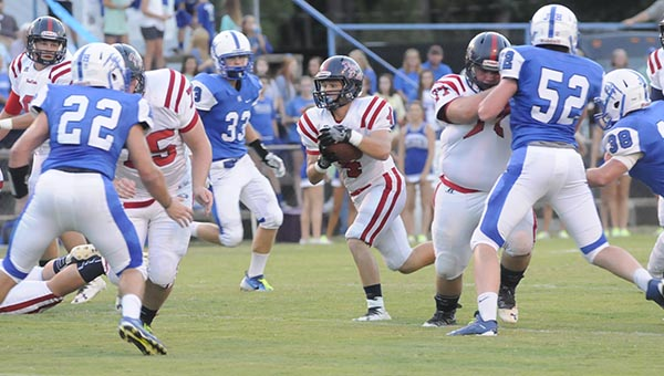 Fort Dale Academy senior running back Andrew Salter finds running room during the first half of the Eagles win against Wilcox Academy Friday night in Camden. (Advocate Staff/Tracy Salter)