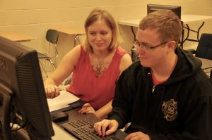 Katie Powell (left) and Jacob Morgan (right) work on computer modules in the Ready to Work Program at the LBWCC Luverne Center (Photo by Beth Hyatt).