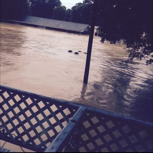 After seeing how high the water had risen, the Martins were forced to evacuate their home and seek shelter.